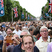 Thousands gathered to watch a parade on The Mall, and up to 100 aircraft representing the RAF over the years fly over Buckingham Palace on 10 July 2018 at The Mall, London, UK.