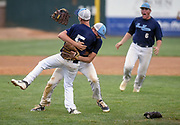 Bon Homme/Scotland's Bryce Scieszinski (12) rushes Bon Homme/Scotland's Trent Herrboldt (5) after Herrboldt records the final out to win the Class B state championship 7-5 over West Central on Tuesday at the Sioux Falls Stadium. (Matt Gade / Republic)