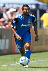 August 21, 2010; Santa Clara, CA, USA;  San Jose Earthquakes midfielder/forward Arturo Alvarez (10) dribbles the ball during the first half against the Los Angeles Galaxy at Buck Shaw Stadium. San Jose defeated Los Angeles 1-0.