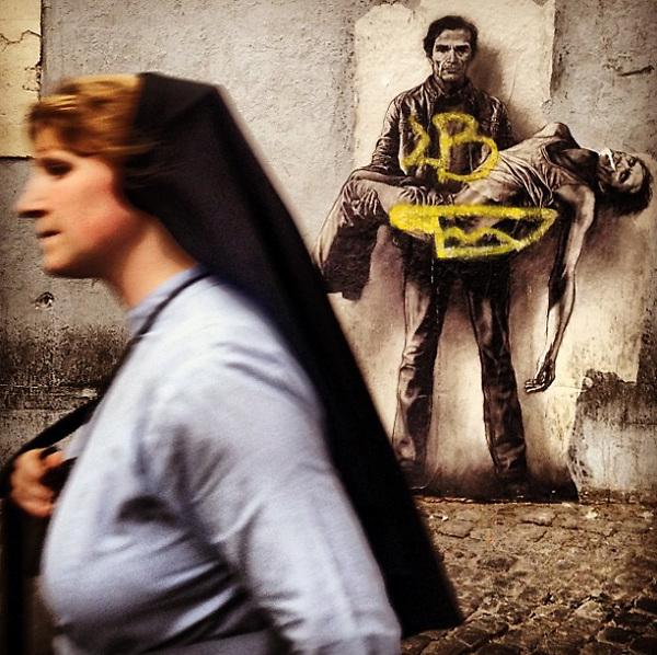 Rome, Trastevere 2015: Nun walking past french artist Ernest Pignon street art tribute to PierPaolo Pasolini