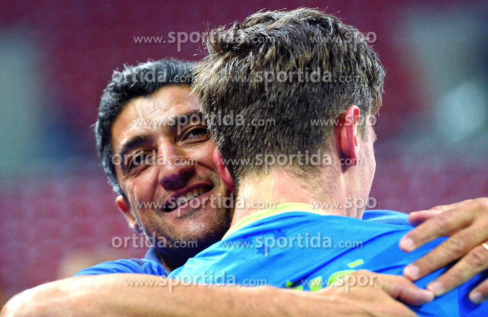 Coach Andrea Giani and Dejan Vincic of Slovenia celebrate after winning during volleyball match between National teams of Poland and Slovenia in Quarterfinals of 2015 CEV Volleyball European Championship - Men, on October 14, 2015 in Arena Armeec, Sofia, Bulgaria. Photo by Ronald Hoogendoorn / Sportida