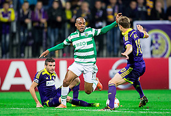 Aleksander Rajcevic of Maribor and Ales Mertelj of Maribor vs João Mário of Sporting during football match between NK Maribor and Sporting Lisbon (POR) in Group G of Group Stage of UEFA Champions League 2014/15, on September 17, 2014 in Stadium Ljudski vrt, Maribor, Slovenia. Photo by Vid Ponikvar  / Sportida.com
