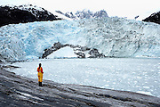 Woman overlooking glacier, Patagonia, Chile