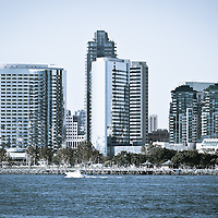 San Diego downtown waterfront buildings and a yacht on San Diego Bay in Southern California.