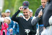 Pep Guardiola takes cap off as he is introduced on the 1st hole during the Celebrity Pro-Am day at Wentworth Club, Virginia Water, United Kingdom on 23 May 2018. Picture by Phil Duncan.