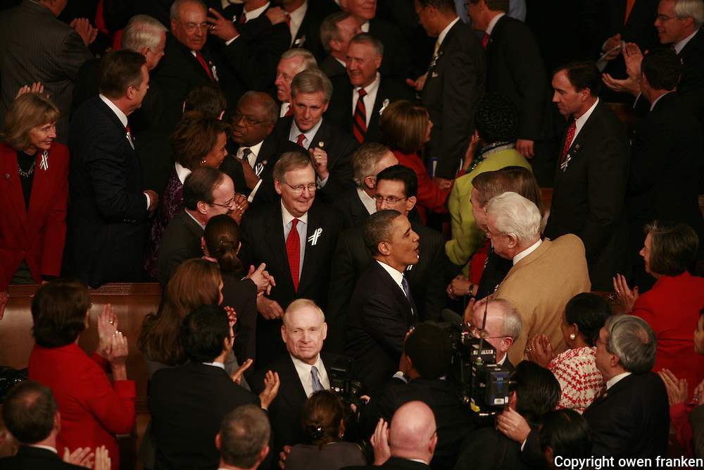 state of the union speech by president obama..the arrival of the President..jan 25-2011state of the union speech by president obama..the arrival of the President..behind Obama are Republican Senate leader Mitch McConnell and from House, . Eric Cantor...jan 25-2011