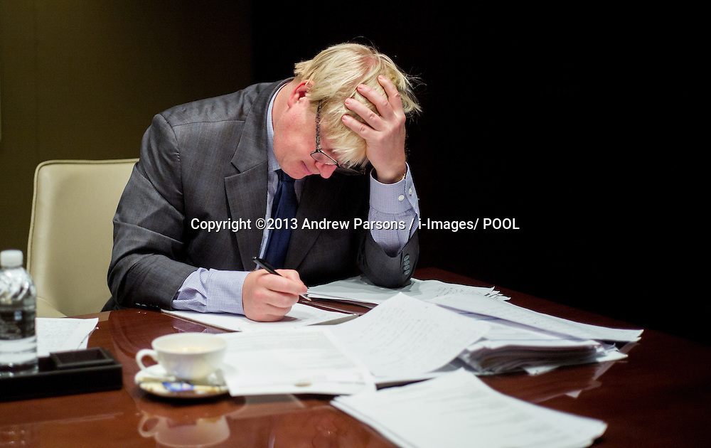 London Mayor Boris Johnson writing his speech in the green room before delivering it to the Go Global conference in Shanghai on Day 5 of a  trade mission to China on his 6 day visit to China. Thursday, 17th October 2013. Picture by Andrew Parsons / i-Images/ POOL