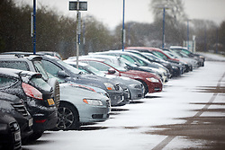 © Licensed to London News Pictures. 13/01/2017. STOKE MANDEVILLE, UK.  General view of the car park at Stoke Mandeville station in Buckinghamshire during a snow flurry. The UK has been hit by the first cold snap of 2017 with significant snow falling across parts of the country. .  Photo credit: Cliff Hide/LNP