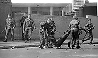 The Silver Jubilee visit of Queen Elizabeth II to N Ireland on 10th & 11th August 1977 sparked serious rioting in Belfast as those opposed to the visit tried to reach the city centre. Soldiers drag an injured colleague to safety.  1977081000744k<br />