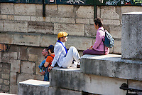 people relaxing by the seine in Paris France in Spring time of May 2008