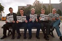 05 OCT 1999, BERLIN/GERMANY:<br /> Hans-Peter Bartels, MdB, SPD, Michael Roth, MdB, SPD, Christian Lange, MdB, SPD, Carsten Schneider, MdB, SPD, und Kurt Bodewig, MdB, SPD, alle Mitherausgeber des Magazins BERLINER REPUBLIK, lesen die Erstausgabe auf einer Parkbank, Alexanderplatz<br /> IMAGE: 19991005-01/02-03
