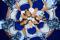 Smiling Cheerleaders standing in circle (portrait) (view from below)