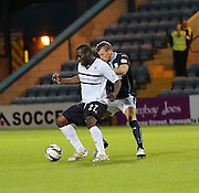 Former Dee Christian Nade holds off Iain Davidson - Dundee v Raith Rovers, Scottish League Cup at Dens Park<br /> <br />  - &copy; David Young - www.davidyoungphoto.co.uk - email: davidyoungphoto@gmail.com