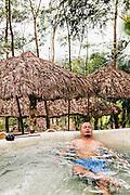 Vietnamese man soaking in a hot tub at My Lam Hot Springs