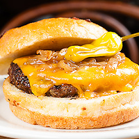 Black Angus Burger<br /> caramelized onions, Pepperoncini &amp; cheddar cheese on a brioche bun.<br /> Jimmy J's Cafe, 115 Chartres St. New Orleans, LA 70130