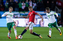 October 8, 2017 - Oslo, NORWAY - 171008  George Saville and Steven Davis of Northern Ireland and Alexander Sørloth of Norway during the FIFA World Cup Qualifier match between Norway and Northern Ireland on October 8, 2017 in Oslo..Photo: Fredrik Varfjell / BILDBYRÃ…N / kod FV / 150028 (Credit Image: © Fredrik Varfjell/Bildbyran via ZUMA Wire)