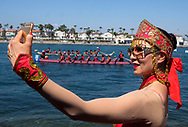 A woman takes selfie photo as dragon boat racers prepare to compete at Long Beach Dragon Boat Festival at Marine Stadium in Long Beach, California, on July 30, 2017. (Photo by Ringo Chiu)<br /> <br /> Usage Notes: This content is intended for editorial use only. For other uses, additional clearances may be required.