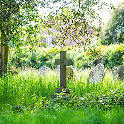Overgrown graveyard in Marlborough Wiltshire UK