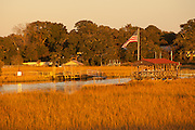Sunset over the marsh on Shem Creek in Mt Pleasant, SC.