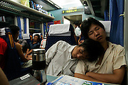 Chinese teens sleeping in train after holidays