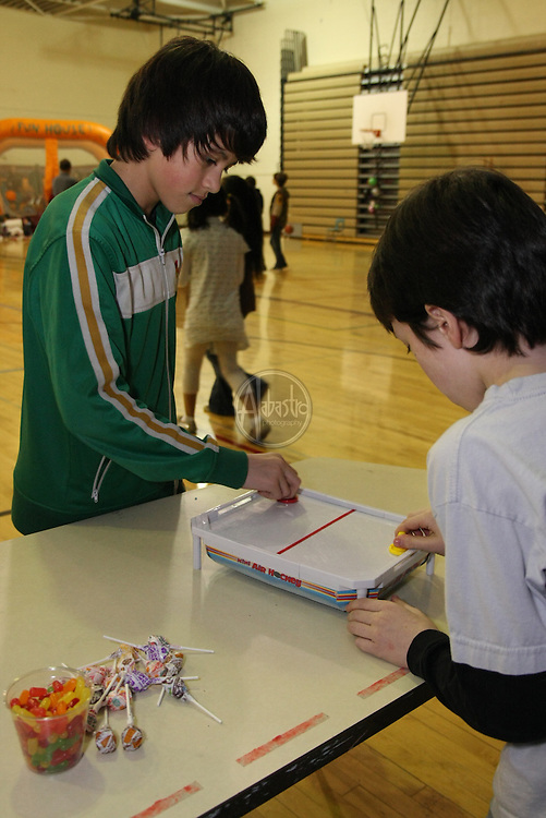 Game Table at HIMS Carnival Night 2010 - 6th graders Andre Alabastro and Marc