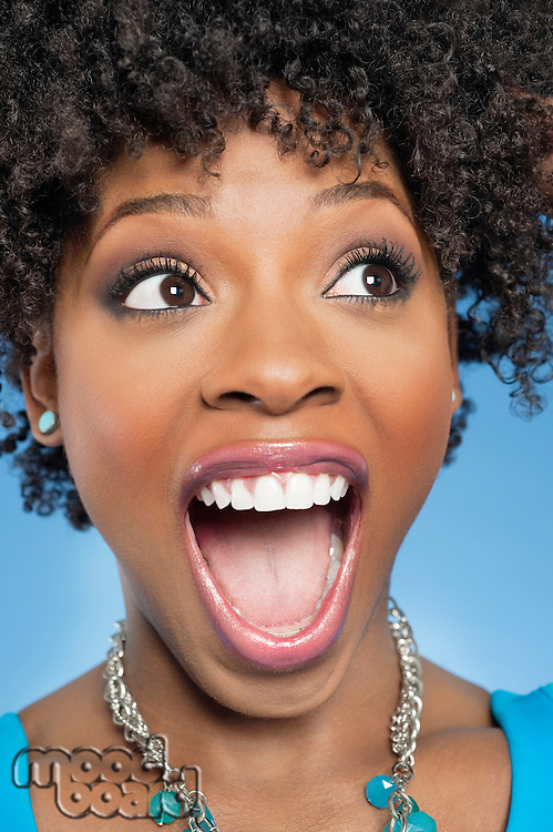 Surprised African American woman looking away with mouth open
