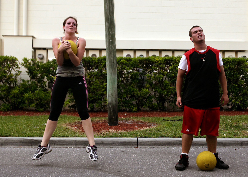 """During the three times a week physical training at the Marine recruiting sub-station in Naples, Elaine Neal, left, continues to hop while holding a medicine ball, while another recruit, Thomas Falcon, tires out. Despite being always outnumbered by the boys, Neal would never back down from competing against them. """"When I go to the workouts with the Marines, I'm one of the most motivated people there"""" Neal said. Greg Kahn/Staff"""