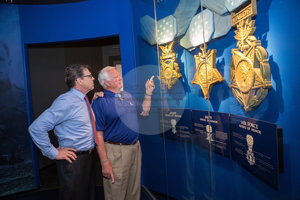 Former Texas Governor and GOP presidential hopeful Rick Perry takes a tour of the Medal of Honor museum with Medal recipient Mike Thornton before holding a town hall aboard the USS Yorktown June 8, 2015 in Mount Pleasant, South Carolina.