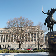 A large statue of Venezuelan leader Simon Bolivar, by Felix de Weldon, that stands in a park in front of the Interior Department (background) in Foggy Bottom in northwest Washington DC. The statue was installed as a gift of the Venezuelan Government in 1955 and is formally titled Equestrian of Simon Bolivar.