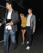 06.MARCH.2012. LONDON<br /> <br /> **EXCLUSIVE PICTURES** <br /> <br /> NICOLA MCLEAN LOOKING A LITTLE WORSE FOR WEAR WEARING NO SHOES AND HAD TO BE HELPED TO THE CAR BY HUSBAND TOM WILLIAMS AND FOOTBALLER FRIEND RICHARD LANGLEY WHO HELD HER SHOES IN LONDON<br /> <br /> BYLINE: EDBIMAGEARCHIVE.COM<br /> <br /> *THIS IMAGE IS STRICTLY FOR UK NEWSPAPERS AND MAGAZINES ONLY*<br /> *FOR WORLD WIDE SALES AND WEB USE PLEASE CONTACT EDBIMAGEARCHIVE - 0208 954 5968*