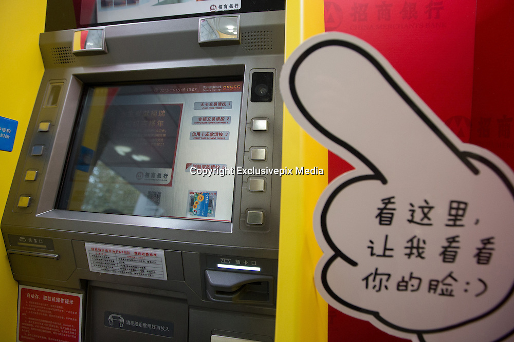 NANJING, CHINA - NOVEMBER 16: (CHINA OUT) <br /> <br /> A face you can bank on: China launches the country's first cash machines using facial recognition technology <br /> <br /> China could soon wave goodbye to bank cards as it rolls out the first of its facial recognition enabled ATMs.<br /> The clever machines were recently made available to customers of China Merchants Bank in the cities of Shenzhen, Nanjing and Qingdao, with more planned for the future.<br /> It is the first time the technology has been made available for public use in China since the technology was unveiled earlier this year<br /> A total of 10 facial recognition ATMs were introduced to China Merchant Bank branches in cities around the country this month - the first of its kind in the country.<br /> Some of the machines were Minions-themed while others were plain. <br /> They allow users to access their bank accounts by scanning their faces, effectively making bank cards redundant.<br /> There are obvious security concerns over the use of the machines and as an added security, users must input their telephone numbers as well as a password.<br /> Staff claims that the machine is even able to distinguish between twins as the visual image processing technology used takes its profile from several parts of the face.<br /> <br /> This has been successfully proved during the product testing stage of the machine.<br /> They also claim a small variation in appearance, including wearing glasses or make-up, shouldn't affect the efficiency of the system.<br /> However, major plastic surgery would require customers to update their photograph used on their identification cards. <br /> The technology eliminates the use of cards. With the average speed of a cash withdrawal reportedly just 42 seconds, it could also speed up the process.<br /> However, users are restricted to a daily withdrawal limit of 3,000 Yuan (£300), compared to conventional methods that allow users to withdrawn up to 20,000 Yuan (£2,000).<br /> <br /> China Merchants Bank now plans to unveil one of two of the machines at its branches around the