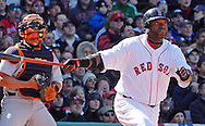 David Ortiz watches a long out into right field.
