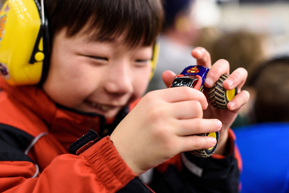 Holden Miller, 8, plays with a toy truck while watching the Monster Truck Nationals at the Veterans Memorial Coliseum at the Alliant Energy Center in Madison, Wis., on Jan. 31, 2016. (Photo by Jeff Miller, www.jeffmillerphotography.com)