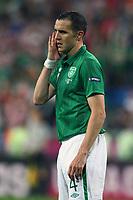 Football - European Championships 2012 - Republic of Ireland v Croatia<br /> John O'Shea of Ireland looks dejected at the Municipal Stadium, Poznan