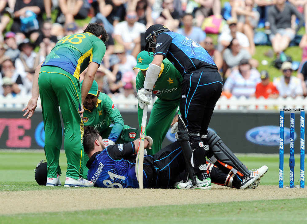 New Zealand's Mitchell McClenaghan on the ground after being hit in the helmet grill against Pakistan in the 1st ODI International Cricket match at Basin Reserve, Wellington, New Zealand, Monday, January 25, 2016. Credit:SNPA / Ross Setford