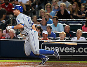 ATLANTA - AUGUST 13:  Outfielder Scott Podsednik #21 of the Los Angeles Dodgers leaves the batter's box during the game against the Atlanta Braves at Turner Field on August 13, 2010 in Atlanta, Georgia.  The Braves beat the Dodgers 1-0. (Photo by Mike Zarrilli/Getty Images)