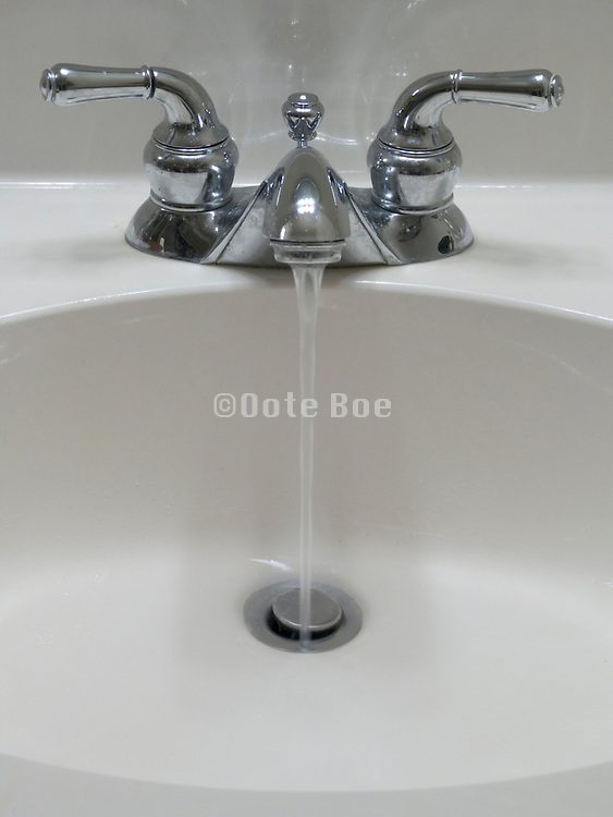 old style faucet with running water
