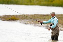 Man fly fishing in Silver Salmon Creek, Lake Clark National Park, Alaska, United States of America
