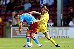Stuart Sinclair of Bristol Rovers tackles Josh Morris of Scunthorpe United  - Mandatory by-line: Matt McNulty/JMP - 06/08/2016 - FOOTBALL - Glanford Park - Scunthorpe, England - Scunthorpe United v Bristol Rovers - Sky Bet League One