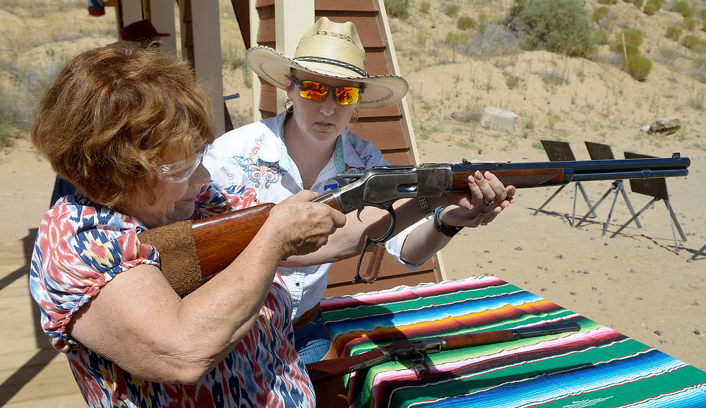 """gbs072917r/RIO-WEST -- Kay Montoya, left, of Albuquerque, gets acquainted with a lever action rifle as Instructor Jennifer Gastelum of Albuquerque watches, during the Rio Grande Renegades Ladies Shoot  at the Albuquerque Shooting Range on Saturday, July 29, 2017. Montoya said this was the first time she has handled firearms. """"I did perfect on the handguns,"""" she said.(Greg Sorber/Albuquerque Journal)"""