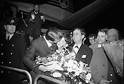 "Seán Dunphy returns to Dublin Airport from Vienna after taking second place in the Eurovision Song Contest with the song ""If I Could Choose"".  Dunphy greets his wife as he steps from the plane to a hero's welcome from thouands of fans crowding the balconies of Dublin Airport..10.04.1967"