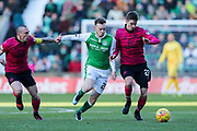 Brandon Barker (#20) of Hibernian and Mikael Lustig (#23) of Celtic battle for possessin of the ball during the Ladbrokes Scottish Premiership match between Hibernian and Celtic at Easter Road, Edinburgh, Scotland on 10 December 2017. Photo by Craig Doyle.