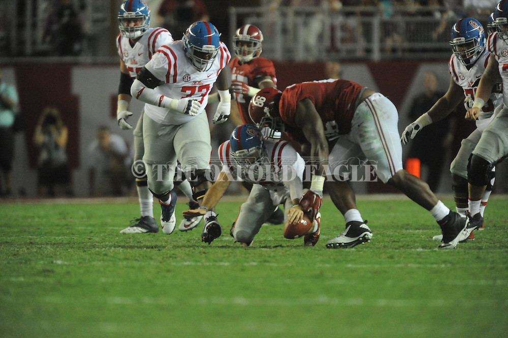 Ole Miss Rebels offensive lineman Rod Taylor (73) recovers a Ole Miss Rebels quarterback Chad Kelly (10) fumble as Alabama Crimson Tide defensive lineman A'Shawn Robinson (86) tries to pick up the ball at Bryant-Denny Stadium in Tuscaloosa, Ala. on Saturday, September 19, 2015. Ole Miss won 43-37.