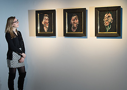 Christie's, London, February 24th 2017. Fine art auctioneers Christie's hold a press preview for their Impressionist and Modern Art and Art of the Surreal sale which takes place on 28th February. PICTURED: A woman admires Three studies for a portrait of George Dyer, Francis Bacon's first ever portrait of his great muse, painted in 1963. The paintings were formerly in the collection of Roald Dahl and appear on the auction market for the first time, with they triptych expected to realise between £50-70million.