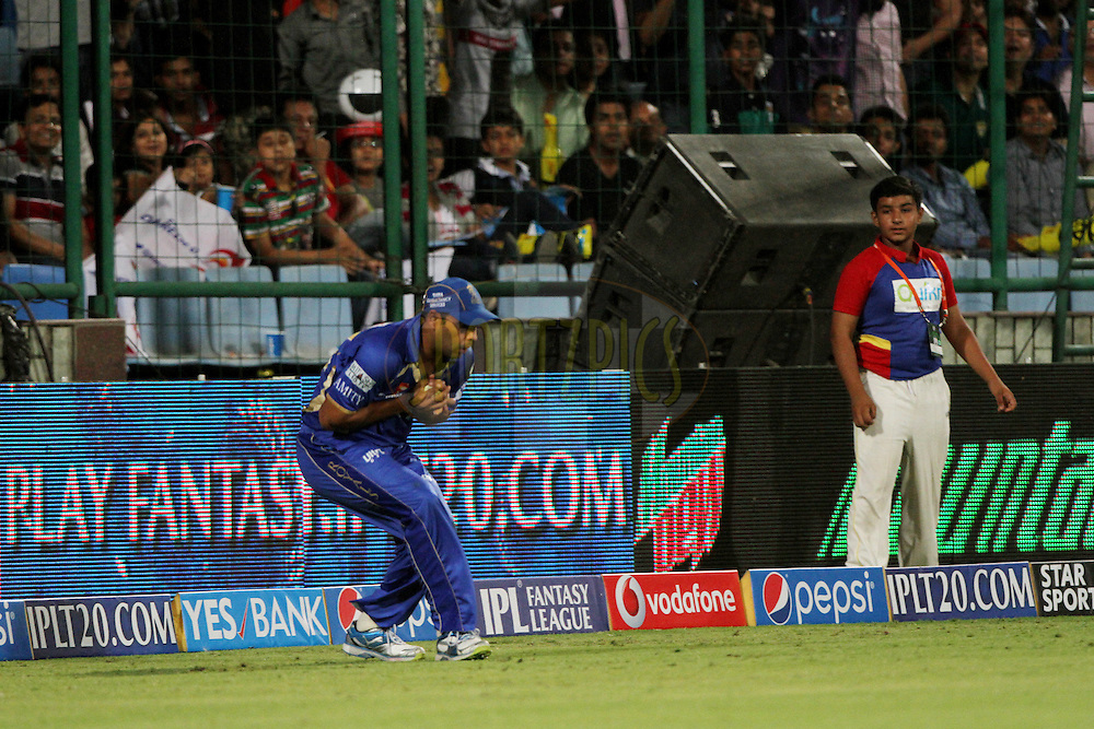 Stuart Binney of the Rajatshan Royals take the catch of Dinesh Karthik of the Delhi Daredevils during match 23 of the Pepsi Indian Premier League Season 2014 between the Delhi Daredevils and the Rajasthan Royals held at the Feroze Shah Kotla cricket stadium, Delhi, India on the 3rd May  2014<br /> <br /> Photo by Deepak Malik / IPL / SPORTZPICS<br /> <br /> <br /> <br /> Image use subject to terms and conditions which can be found here:  http://sportzpics.photoshelter.com/gallery/Pepsi-IPL-Image-terms-and-conditions/G00004VW1IVJ.gB0/C0000TScjhBM6ikg