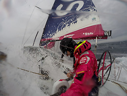October, 2014. Leg 1 onboard Team SCA. Stacey Jackson prepares to take a wave during her watch.
