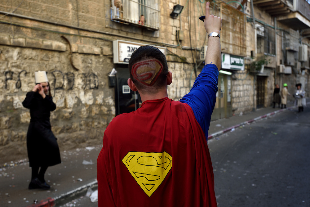 A Jewish man wearing Superman costume during Purim Holiday in the Ultra-Orthodox Jewish neighbourhood of Mea Shearim in Jerusalem, on March 6, 2015. The Jewish holiday of Purim commemorates the salvation of the Jews living with in the borders of the ancient Persian Empire. Purim customs include food gifts, charity, wearing costumes and drinking heavily.