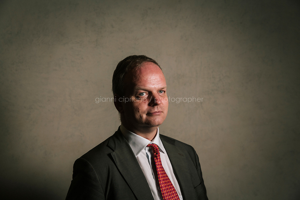 FLORENCE, ITALY - 3 JUNE 2018: Uffizi Director Eike Schmidt poses for a portrait at the Uffizi, in Florence, Italy, on June 3rd 2018.<br /> <br /> As of Monday June 4th 2018, Room 41 or the &ldquo;Raphael and Michelangelo room&rdquo; of the Uffizi is part of the rearrangement of the museum's collection that has<br /> been defining Uffizi Director Eike Schmidt&rsquo;s grander vision for the Florentine museum.<br /> Next month, the museum&rsquo;s Leonardo three paintings will be installed in a<br /> nearby room. Together, these artists capture &ldquo;a magic moment in the<br /> first decade of the 16th century when Florence was the cultural and<br /> artistic center of the world,&rdquo; Mr. Schmidt said. Room 41 hosts, among other paintings, the dual portraits of Agnolo Doni and his wife Maddalena Strozzi painted by Raphael round 1504-1505, and the &ldquo;Holy Family&rdquo;, that Michelangelo painted for the Doni couple a year later, known as the<br /> Doni Tondo.