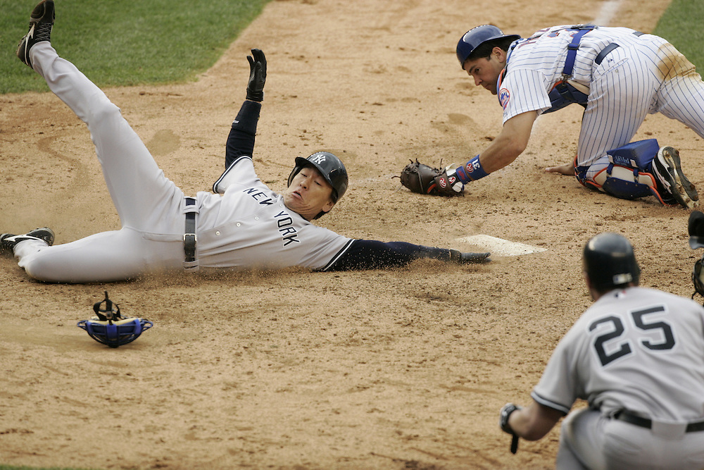 &quot;Safe at Home&quot; .Hideki Matsui of the New York Yankees slides safe into home past Mike Pizza of the New York Mets. Sunday May 22 2005.<br />