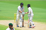 Kane Williamson of the New Zealand Black Caps congratulates Ross Taylor of the New Zealand Black Caps on his 50th run during Day 3 on the 15th of November 2015. The New Zealand Black Caps tour of Australia, 2nd test at the WACA ground in Perth, 13 - 17th of November 2015.   Photo: Daniel Carson / www.photosport.nz